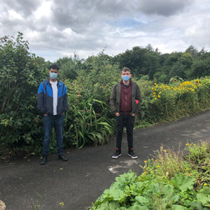 Aron and Steve outside wearing masks